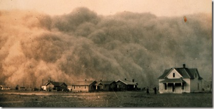 A dust storm envelops houses in Stratford, Texas, 1935. These massive storms, called 'black blizzards' or 'black rollers,' could reduce visibly to just a few feet.